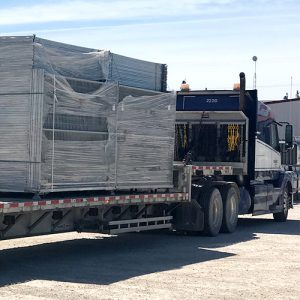 Full truck shipping fence panels.